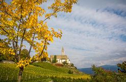 Autumn view of the Church of the idyllic village of Cortaccia. Cortaccia extends on the sunny side of the wine road. South Tyrol, Stock Image