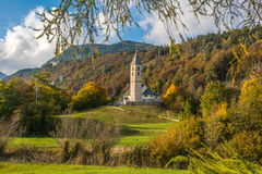 Autumn view of the Church of the idyllic village of Favogna di Sotto, South Tyrol, Italy. Autumn view of the Church of the idyllic village of Favogna di Sotto Stock Photo