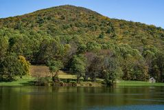View of Flat Top Mountain. An autumn view of Flat Top Mountain by Abbott Lake located at the Peaks of Otter, Blue Ridge Parkway, Bedford County, Virginia, USA royalty free stock images