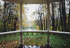 Autumn view from the gazebo. Beautiful autumn landscape on the view from the gazebo to the pond and forest Stock Images
