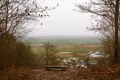 Autumn view of green meadows from the top of a hill stock image