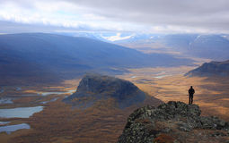 Autumn view. Hiker looking at arctic rivervalley in autumn colors Stock Photography
