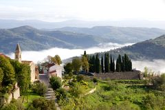 Autumn view of hills and low cloud from Motovun, Croatia. Motovun is a tiny medieval hilltop town in Istria, Croatia. It's not uncommon in the mornings for cloud stock photo