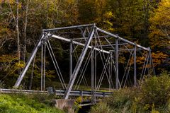 Historic Pratt Truss Bridge - East Fork Greenbrier River, West Virginia. An autumn view of a historic one-lane Pratt through truss bridge over the East Fork Royalty Free Stock Photo
