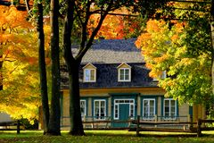 Autumn view of a canadian historic stone house royalty free stock photography