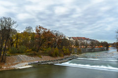 Autumn view with Isar river in Munich, Germany Stock Photos