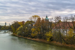 Autumn view with Isar river in Munich, Germany Royalty Free Stock Image