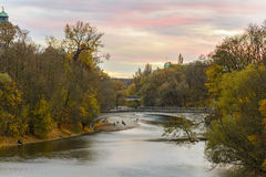 Autumn view with Isar river in Munich, Germany Royalty Free Stock Images