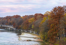 Autumn view with Isar river in Munich, Germany Royalty Free Stock Photos
