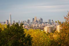 View of London skyline from the distance on a sunny autumn day stock photos