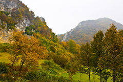 Autumn view of mountain ridge in fog. Kalnik, Croatia Royalty Free Stock Photo