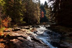 Autumn view of the Mumlava River. Krkonose National Park in the Czech Republic. Waterfall on the river. Stock Photo