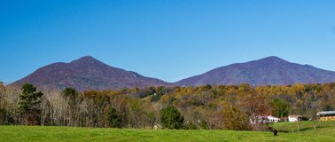 A Commanding view of the Peaks of Otter, Bedford County, Virginia, USA. Autumn view of the Peaks of Otter located in the Blue Ridge Mountains located in Bedford stock image