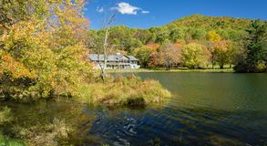 Autumn View of the Peaks of Otter Lodge. Bedford County, VA – October 24th: An autumn view of Peaks of Otter Lodge by Abbott Lake located at the Peaks of royalty free stock image