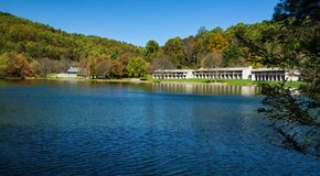 Autumn View of the Peaks of Otter Lodge. Bedford County, VA – October 24th: An autumn view of Peaks of Otter Lodge by Abbott Lake located at the Peaks of stock photography