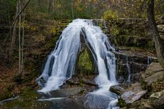 An autumn view of Roaring Run Waterfall located in Eagle Rock in Botetourt County, Virginia. An autumn view of the Roaring Run waterfall on Roaring Run Creek is stock photography