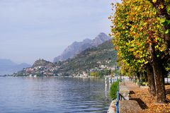 Autumn view from Sale Marasino over Iseo Lake. Marone town to the right. Lago d`Iseo or Sebino is the fourth largest lake in Lombardy, Italy, fed by the Oglio royalty free stock photos