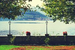 Autumn view from Sale Marasino over Iseo Lake. Monte Isola in background. Lago d`Iseo or Sebino is the fourth largest lake in Lombardy, Italy, fed by the Oglio royalty free stock images