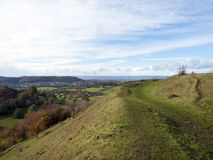 Autumn view, Uley Bury, Cotswolds, Gloucestershire, UK. First signs of autumn colour on Uley Bury iron age hill fort, Cotswolds, Gloucestershire, UK Stock Images