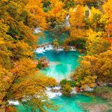 Autumn view on waterfalls and lakesl with turquoise water and g Stock Photos