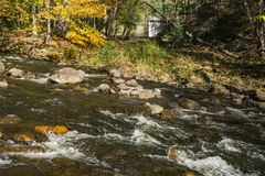 Autumn View of Wilson Creek. An autumn view of Wilson Creek with the middle dam in the background located in Douthat Lake State Park located at Millboro Stock Photography