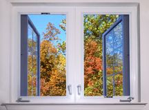 Autumn view from window. Autumn view from opened window Royalty Free Stock Photography