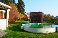 Autumn in the village. Autumn Landscape village, swimming pool and the autumn colors Royalty Free Stock Photography