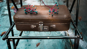 Autumn, vintage. old leather suitcase on a turquoise background Stock Photo