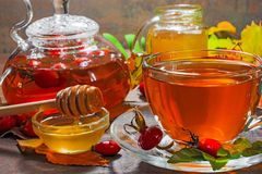 Autumn vitamin drink. glass of hot berry tea with honey Royalty Free Stock Image