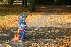 Autumn walk. Cute boy holding shovels at the autumn walk Royalty Free Stock Images