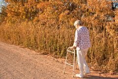 Autumn Walk. Going uphill doesn't deter an autumn lady from taking an autumn stroll Royalty Free Stock Photos