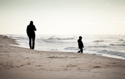 Autumn walk on a beach Stock Photography