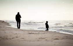 Autumn walk on a beach Stock Photography