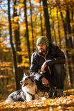 Autumn walk with dog. Autumn walk with border collie dog Royalty Free Stock Images