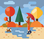 Autumn walk with dog puddles umbrella nature park Royalty Free Stock Image