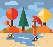 Autumn walk with dog puddles umbrella nature park Royalty Free Stock Image