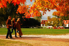 An Autumn Walk. Folks enjoy an autumn walk in Colonial Williamsburg Royalty Free Stock Images