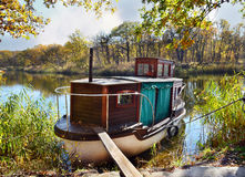 Autumn, water, landscape. Small ship Stock Images