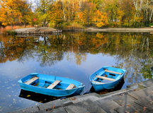 Autumn, water, landscape. Two boats on the lake, pond. Stock Image