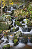 Autumn waterfall. Scene in the mountains Royalty Free Stock Photo