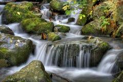 Autumn waterfall. Scene in the mountains Stock Photo