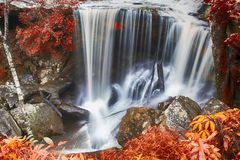Autumn waterfall in deep forest Stock Photos