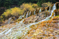 Autumn waterfall in huanglong stock image