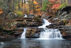 Autumn Waterfall in mountain Stock Photo