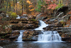 Autumn Waterfall in mountain with foliage Royalty Free Stock Images