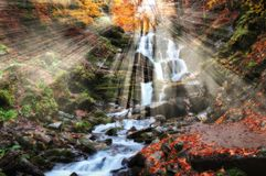 Autumn waterfall, picturesque waterfall in the Carpathian Mountains Stock Photo