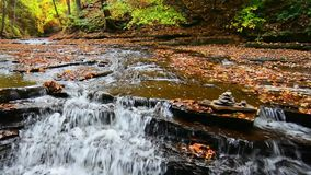 Autumn Waterfall. A small waterfall on Brandywine Creek in Cuyahoga Valley National Park Ohio. Seen here in autumn with colorful fallen leaves stock video footage