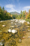 An autumn waterway along the Kancamagus Highway in the White Mountain National Forest, New Hampshire Royalty Free Stock Images
