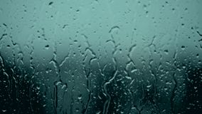 Autumn weather storm, covered with water drops, condensation, bubbles, wash, clean, image of cloud and rain forecast, water resist. Drops of rain on glass stock video