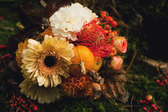 Autumn wedding bouquet. In the boho style is the coating of moss with berries Royalty Free Stock Photo